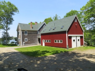Large 3-4 bedroom house and a huge barn with two 1-bedroom apartments above.